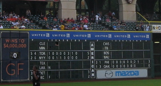 The scoreboard around gametime, featuring a loss by Kansas City and a near-loss by Oakland.